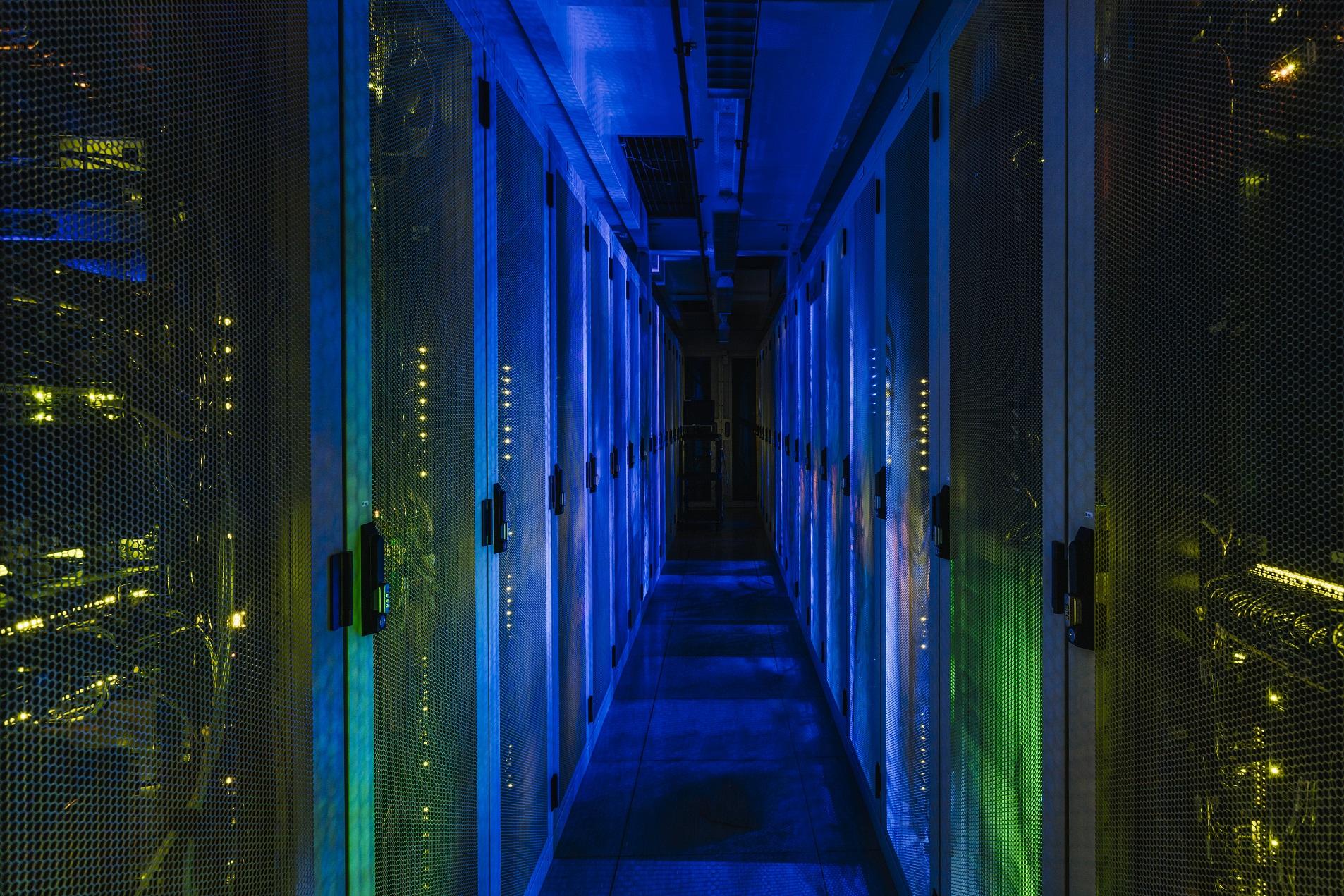 ams-1-data-center-cabinet-row-lit-2